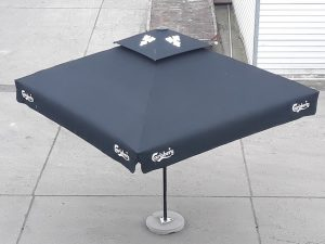Black metal parasol umbrella with Carlsberg branding printed on the sides and top
