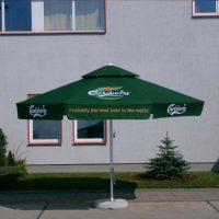 Green metal parasol umbrella with Carlsberg printed branding.